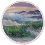 Green Hills And Fog At Sunrise Round Beach Towel