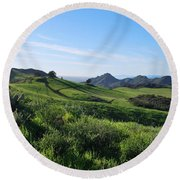Round Beach Towel featuring the photograph Green Hills Landscape With Cactus by Matt Harang