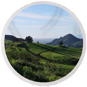 Round Beach Towel featuring the photograph Green Hills Purple Flowers Foreground  by Matt Harang