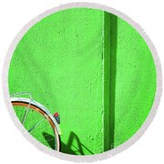 Round Beach Towel featuring the photograph Green Wall And Bicycle Wheel by Silvia Ganora