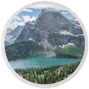 Grinnell Lake From Afar Round Beach Towel by Alpha Wanderlust