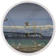 Gulls Flying By The Bridge At The Straits Of Mackinac Round Beach Towel by Randall Nyhof