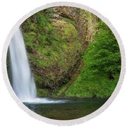 Round Beach Towel featuring the photograph Gushing Horsetail Falls by Greg Nyquist