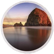 Round Beach Towel featuring the photograph Haystack Rock Sunset by Adam Romanowicz