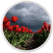 Heavy Clouds Over Red Tulips Round Beach Towel by Mihaela Pater