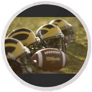 Helmets And A Football On The Field At Dawn Round Beach Towel