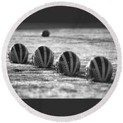 Helmets On Dew-covered Field At Dawn Black And White Round Beach Towel