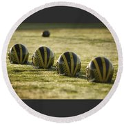 Helmets On Dew-covered Field At Dawn Round Beach Towel