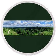 Hills And Clouds Round Beach Towel