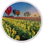 Round Beach Towel featuring the photograph Hot Air Balloons Over Tulip Fields by William Lee