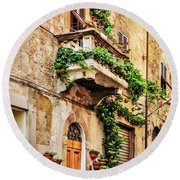 Round Beach Towel featuring the photograph House In Arezzoo, Italy by Marion McCristall