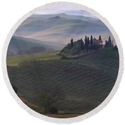 Round Beach Towel featuring the photograph House In Tuscany In The Morning Fog by IPics Photography