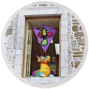 Round Beach Towel featuring the photograph How Much Is That Dragon In The Window by John Schneider