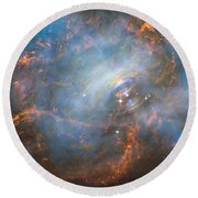 Round Beach Towel featuring the photograph Hubble Captures The Beating Heart Of The Crab Nebula by Nasa