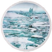 Round Beach Towel featuring the photograph Ice Galore In The Jokulsarlon Glacier Lagoon Iceland by Matthias Hauser
