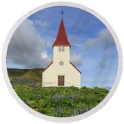 Round Beach Towel featuring the photograph Icelandic Church Among The Fields Of Lupine by Edward Fielding