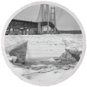 Round Beach Towel featuring the photograph Icy Black And White Mackinac Bridge  by John McGraw