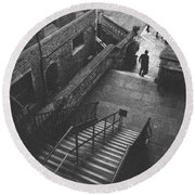 In Pursuit Of The Devil On The Stairs Round Beach Towel by Joseph Westrupp