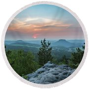 In The Land Of Mesas Round Beach Towel