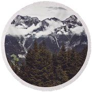 In The Mountains Round Beach Towel by Daniel Precht