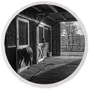 Round Beach Towel featuring the photograph Inside The Horse Barn Black And White by Edward Fielding