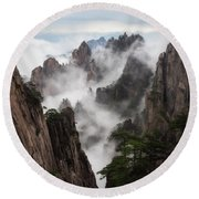 Invisible Hands Painting The Mountains. Round Beach Towel