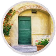 Round Beach Towel featuring the photograph Italian Facade With Geraniums by Silvia Ganora