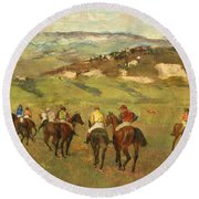 Jockeys On Horseback Before Distant Hills Round Beach Towel