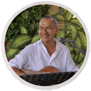 Round Beach Towel featuring the photograph Jose Luis Cobo by Jim Walls PhotoArtist