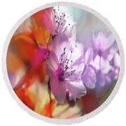 Round Beach Towel featuring the photograph Juego Floral by Alfonso Garcia