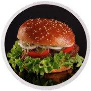 Juicy, Tasty Hamburger On A Black Background Round Beach Towel