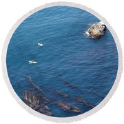 Kayaks And Seaweed In Channel Islands Round Beach Towel