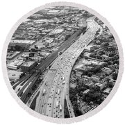 Round Beach Towel featuring the photograph Kennedy Expressway And Chicago Skyline by Adam Romanowicz