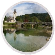 Lake Bohinj With Church In Slovenia Round Beach Towel