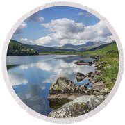 Lake Mymbyr And Snowdon Round Beach Towel by Ian Mitchell