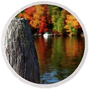 Lake Winnepesaukee Dock With Foliage In The Distance Round Beach Towel