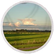 Land And Clouds Round Beach Towel