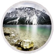 Landscape Of Plansee Lake And Alps Mountains During Winter, Snowy View, Tyrol, Austria. Round Beach Towel