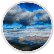 Layers Of Clouds On Mount Evans Round Beach Towel