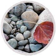 Leaf On River Rocks Round Beach Towel