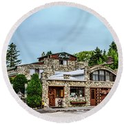 Round Beach Towel featuring the photograph Legs Inn Of Cross Village by Bill Gallagher