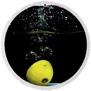 Lemon Dropped Into Water  Round Beach Towel