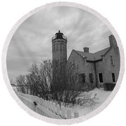 Round Beach Towel featuring the photograph Lighthouse And Mackinac Bridge Winter Black And White  by John McGraw