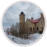Round Beach Towel featuring the photograph Lighthouse And Mackinac Bridge Winter by John McGraw