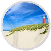 Round Beach Towel featuring the photograph lighthouse Eierland by Hannes Cmarits