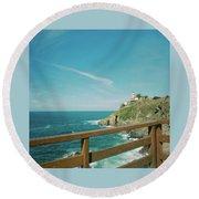 Lighthouse Over The Ocean Round Beach Towel