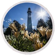 Lighthouse With A Flowery Foreground Round Beach Towel