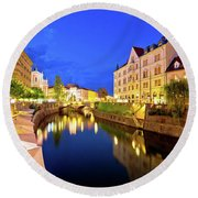 Ljubljanica River Waterfront In Ljubljana Evening View Round Beach Towel by Brch Photography