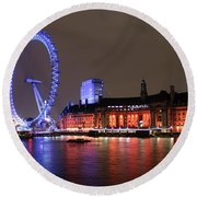 Round Beach Towel featuring the photograph London Eye By Night by RKAB Works