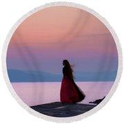 Lone Figure On The Cob, Lyme Regis, Dorset, Uk, At Sunrise. Round Beach Towel